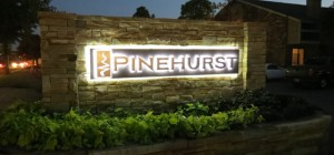 Photo of the custom logo monument sign designed by Electremedia for Pinehurst Apartments in Oklahoma City.