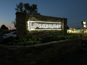 Photo of custom logo monument sign designed by Electremedia for Pinehurst Apartments in Oklahoma City.