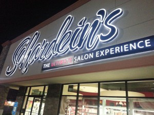 Photo of large logo sign for salon.