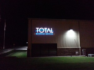 Nighttime picture of illuminated channel letter logo sign.