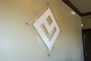 Photo of diamond shaped acrylic wall sign.