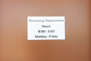 Photo of door sign that says receiving.