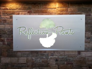 Front photograph of new custom wall sign.
