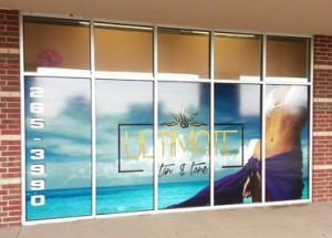 A picture of a vinyl window mural spanning 5 storefront windows.